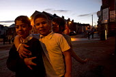 Roma children, mostly from Slovakia, playing in the streets, Page Hall, Sheffield, Yorkshire - Jess Hurd - 2010s,2013,BAME,BAMEs,BEMM,BEMMs,bigotry,Black,BME,bmes,boy boys,CHILD,CHILDHOOD,children,children child,Diaspora,discrimination,diversity,dusk,equal,equality,ethnic,ethnicity,evening,excluded,exclusi