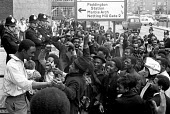 Black youth celebrating as a defendent is aquitted and released outside Marylebone Magistrates Court after police made arrests at a Notting Hill Club, the Metro Youth Club, London - Peter Arkell - 1970s,1971,activist,activists,adult,adults,arrest,arrested,arresting,BAME,BAMEs,BEMM,BEMMs,Black,BME,bmes,CAMPAIGN,campaigner,campaigners,CAMPAIGNING,CAMPAIGNS,CELEBRATE,celebrating,CLJ,club,club arre