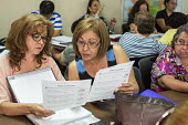 Las Vegas, Nevada - Immigrants studying for the U.S. citizenship test in a free class sponsored by the Culinary Union and the Clark County School District - Jim West - 12-07-2016