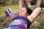 Reading Rosa Luxemburg on a hay bail at Tolpuddle Martyrs' Festival 2016. Dorset. - Jess Hurd - 17-07-2016