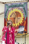 Diane Holland, UNITE Tolpuddle Martyrs' Festival 2016. Dorset. - Jess Hurd - 2010s,2016,ACE,Agricultural workers union,AWU,banner,banners,Diane Holland,Dorset,FEMALE,Festival,FESTIVALS,member,member members,members,PEOPLE,person,persons,SPEAKER,SPEAKERS,speaking,SPEECH,SWTUC,T