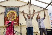 Freed Miami 5 introduced by Diane Holland, UNITE, speaking at Tolpuddle Martyrs' Festival 2016. Dorset. - Jess Hurd - 2010s,2016,ACE,Agricultural workers union,AWU,banner,banners,campaign,campaigning,CAMPAIGNS,cuban,cubans,Diane Holland,Dorset,FEMALE,Festival,FESTIVALS,free,member,member members,members,Miami 5,PEOPL