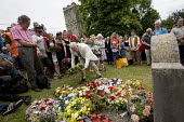 Jeremy Corbyn laying a wreath in memory of the martyrs, Tolpuddle Martyrs Festival 2016. Dorset. - Jess Hurd - 2010s,2016,ACE,cemeteries,cemetery,Dorset,Festival,FESTIVALS,floral,flower,flowering,flowers,grave,graves,gravestone,gravestones,graveyard,Graveyards,Jeremy Corbyn,Labour Party,lay,laying,member,membe