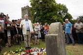 Jeremy Corbyn speaking after laying a wreath in memory of the martyrs, Tolpuddle Martyrs Festival 2016. Dorset. - Jess Hurd - 2010s,2016,ACE,cemeteries,cemetery,Dorset,Festival,FESTIVALS,floral,flower,flowering,flowers,grave,graves,gravestone,gravestones,graveyard,Graveyards,Jeremy Corbyn,Labour Party,lay,laying,member,membe