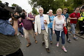 Jeremy Corbyn with gifted Dorset Marmalade from a supporter at Tolpuddle Martyrs' Festival 2016. Dorset. - Jess Hurd - 2010s,2016,ACE,camera,cameras,communicating,communication,Dorset,Festival,FESTIVALS,filming,Jeremy Corbyn,Labour Party,Marmalade,member,member members,members,PEOPLE,supporter,SWTUC,Television,Tolpudd