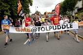 GMB marchers Tolpuddle Martyrs' Festival 2016. Dorset. - Jess Hurd - 2010s,2016,ACE,banner,banners,Dorset,Festival,FESTIVALS,GMB,member,member members,members,PEOPLE,SWTUC,Tolpuddle Martyrs festival,Tolpuddle Martyrs' Festival,trade union,trade union,trade unions,trade