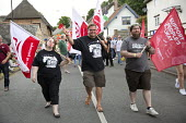Manuel Cortes, TSSA marching Tolpuddle Martyrs' Festival 2016. Dorset. - Jess Hurd - 2010s,2016,ACE,Dorset,FEMALE,Festival,FESTIVALS,flag,flags,Manuel Cortes,marching,member,member members,members,PEOPLE,person,persons,SWTUC,Tolpuddle Martyrs festival,Tolpuddle Martyrs' Festival,trade