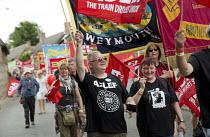 ASLEF marching Tolpuddle Martyrs' Festival 2016. Dorset. - Jess Hurd - 2010s,2016,ACE,ASLEF,banner,banners,Dorset,FEMALE,Festival,FESTIVALS,male,man,marching,member,member members,members,men,PEOPLE,person,persons,SWTUC,Tolpuddle Martyrs festival,Tolpuddle Martyrs' Festi