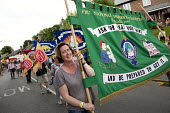FBU women marching at Tolpuddle Martyrs Festival 2016. Dorset. - Jess Hurd - J Howard Miller,2010s,2016,ACE,banner,banners,Dorset,equal rights,equality,FBU,FEMALE,feminism,feminist,feminists,Festival,FESTIVALS,icon,iconography,image,images,J. Howard Miller,marching,member,memb