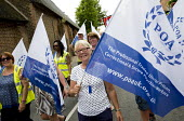 POA marching at Tolpuddle Martyrs' Festival 2016. Dorset. - Jess Hurd - 2010s,2016,ACE,banner,banners,Dorset,FEMALE,Festival,FESTIVALS,FLAG,flags,marching,member,member members,members,PEOPLE,person,persons,POA,SWTUC,Tolpuddle Martyrs festival,Tolpuddle Martyrs' Festival,