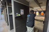 Las Vegas, Nevada - A man fires his handgun at the Discount Firearms + Ammo indoor shooting range. - Jim West - 2010s,2016,aim,aiming,defence,defences,defense,Ear Protectors,firearm,firearms,firing,firing range,gun,gun control,guns,handgun,handguns,hobbies,hobby,hobbyist,indoor,indoors,inside,Las Vegas,Leisure,