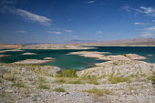 Las Vegas, Nevada drought. The water level in Lake Mead has fallen 150 feet and is now at 37% of capacity due to drought in the West. Islands appear in Echo Bay were land was underwater when the reser... - Jim West - 22-06-2016