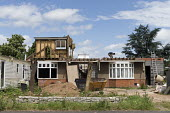 Man demolishing a bungalow to rebuild a house in a desirable location, Stratford upon Avon, Warwickshire - John Harris - 08-07-2016