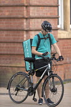 Deliveroo riders delivering takeaway food by bicycle Leamington Spa, Warwickshire - John Harris - 30-07-2016