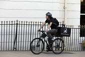 Deliveroo riders delivering takeaway food by bicycle Leamington Spa, Warwickshire - John Harris - self employed,2010s,2016,away,bicycle,bicycles,BICYCLING,Bicyclist,Bicyclists,BIKE,BIKES,by hand,carries,carry,carrying,collecting,contracts,Courier,Couriers,cycle,cycles,cycling,Cyclist,Cyclists,deli