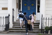 Chinese students arriving at their accommodation, Leamington Spa, Warwickshire - John Harris - 2010s,2016,accommodation,apartment,apartments,ARRIVAL,arrivals,arrive,arrives,arriving,asian,asians,bag,bags,BAME,BAMEs,BEMM,BME,bmes,by hand,carries,carry,carrying,chinese,diversity,door,doors,doorst