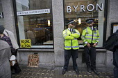 Protest outside Byron Hamburgers branch after an immigration raid, Holborn, London. The chain was accused of entrapment after telling workers without correct immigration documents to attend a staff me... - Jess Hurd - 2010s,2016,activist,activists,adult,adults,branch,BRANCHES,Byron burger,CAMPAIGNING,CAMPAIGNS,catering,CLJ,criminalisation,criminalise,criminalize,DEMONSTRATING,demonstration,DEMONSTRATIONS,deportatio