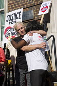 Carol Duggan, aunt of Mark Duggan hugs mother of Jermaine Baker. Five years since the Tottenham Riots the Mark Duggan Justice Campaign Day of Action, Remembrance and Community Healing protest from Bro... - Jess Hurd - 2010s,2016,5th,activist,activists,adult,adults,anniversary,Anti Racism,anti racist,BAME,BAMEs,black,BME,bmes,Broadwater Farm,campaign,campaigner,campaigners,CAMPAIGNING,CAMPAIGNS,comforting,Day of Act