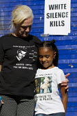 Carol Duggan with the daughter of Mark Duggan. Five years since the Tottenham Riots the Mark Duggan Justice Campaign Day of Action, Remembrance and Community Healing protest from Broadwater Farm to To... - Jess Hurd - 06-08-2016