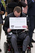 Disabled commuter campaigning for guards. Southern Rail passengers take a petition calling for fair fares and compensation to the Department of Transport, Westminster, Victoria Station London - Jess Hurd - 11-08-2016