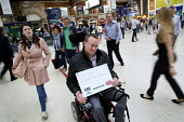 Disabled commuter campaigning for guards. Southern Rail passengers take a petition calling for fair fares and compensation to the Department of Transport, Westminster, Victoria Station London - Jess Hurd - 2010s,2016,activist,activists,adult,adults,Association of British Commuters,bound,CAMPAIGN,campaigning,CAMPAIGNS,COMMUTE,commuter,COMMUTERS,COMMUTING,DEMONSTRATING,demonstration,Department,Department