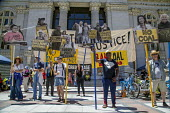 California, No Coal Climate Justice rally at Oakland City Hall opposing the construction of a terminal at the port for loading coal onto ships. The coal would be transported on frequent huge trains th... - David Bacon - 25-06-2016