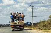 Siem Reap, Cambodia, students from Ngee Ann Polytechnic, Singapore in the back of a lorry on their way to volantary work - David Bacon - 27-12-2015