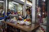 Battambang, Cambodia, woman sewing clothes in a stall in the Phsar Nath Market - David Bacon - 24-12-2015