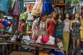 Battambang, Cambodia, woman sewing clothes, stall in Phsar Nath Market - David Bacon - 24-12-2015