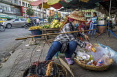 Battambang, Cambodia, Phsar Nath Market, preparing and selling food - David Bacon - 2010s,2015,Asia,asian,asians,baguette,Battambang,bread,cafe,cafes,Cambodia,cambodian,cambodians,catering,chairs,cities,City,cook,COOKERY,cooking,cooks,EARNINGS,EBF,Economic,Economy,employee,employees,