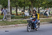 Battambang, Cambodia, mother and child riding a moped - David Bacon - 24-12-2015
