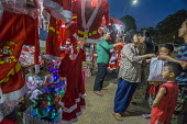 Battambang, Cambodia, Christmas stall selling Santa Claus costumes - David Bacon - 24-12-2015