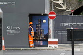 Vehicle banksman on a construction site in central London. New luxury flats and apartments - Philip Wolmuth - builders, building, construction, worker,2010s,2016,apartment,apartments,BAME,BAMEs,banksman,BEMM,Black,blocks,BME,bmes,Brownfield Site,builder,builders,building,building site,Building Worker,building
