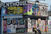 Gentrification in east London. Graffiti and street art on an empty building awaiting demolition, Hackney Wick. Shithouse to Penthouse - Philip Wolmuth - 05-08-2016