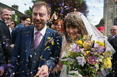 Hannah Edwards and Kieran Durkan getting married, being showered with confetti as they leave the church, Yorkshire - John Harris - 13-08-2016