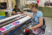 Las Vegas, Nevada - People with intellectual disabilities participate in the Fine Art Program run by the nonprofit Opportunity Village, hand painting silk scarves. The artists are paid a commission wh... - Jim West - 30-06-2016