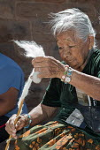 Ganado, Arizona, Navajo Nation, Woman using a Navajo spindle to spin wool into yarn. Wool and Weaving Workshop, Hubbell Trading Post National Historic Site - Jim West - 10-07-2016