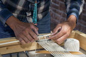 Ganado, Arizona, Navajo Nation, weaving a horse cinch. Wool and Weaving Workshop, Hubbell Trading Post National Historic Site - Jim West - 2010s,2016,ACE,Amerindian,Amerindians,apparel,Arizona,arts,BAME,BAMEs,BEMM,BEMMs,BME,bmes,cinch,clothes,clothing,craft,craftsman,culture,diversity,ethnic,ethnicity,Ganado,GARMENT,hands,heritage,Histor
