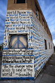 Detroit, Michigan,World Peace mural painted on the walls of a vacant building by Miami artist Renda Writer - Jim West - 2010s,2016,ACE,Anti War,Antiwar,art,artist,ARTISTS,arts,artwork,artworks,building,BUILDINGS,Campaign for Nuclear Disarmament,CND,CND Symbol,culture,Detroit,Michigan,movement,mural,MURALS,Pacifism,pain