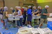 Detroit, Michigan, Volunteers prepare packages of food for hungry children. The packages include rice, soy, dehydrated vegetables, and vitamins. They are distributed by Kids Against Hunger in Detroit... - Jim West - 2010s,2016,Against,aid,assistance,charitable,charity,child,CHILDHOOD,children,community service,Detroit,diverse,diversity,FEMALE,food,food packages,food packets,FOODS,giving,help,helping,HELPS,humanit