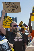 Detroit, Michigan - About a dozen Donald Trump supporters mixed with several hundred against an appearance by Republican Presidential candidate Donald Trump at the Detroit Economic Club - Jim West - 2010s,2016,activist,activists,against,bike,biker,bikes,campaign,campaigner,campaigners,CAMPAIGNING,CAMPAIGNS,candidate,CANDIDATES,DEMOCRACY,DEMONSTRATING,demonstration,DEMONSTRATIONS,Detroit,Detroit E