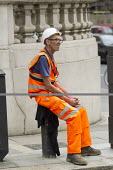Construction worker with video badge having a break in the summer heat, Knightsbridge, London. VB-100 body worn video camera system is styled as an ID card holder worn around the neck - Jess Hurd - 25-08-2016