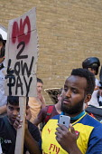 Striking UberEats food delivery couriers protest outside the groups London HQ over pay cuts. - Philip Wolmuth - 2010s,2016,activist,activists,against,BAME,BAMEs,BEMM,BEMMs,Black,BME,bmes,CAMPAIGN,campaigner,campaigners,CAMPAIGNING,CAMPAIGNS,casual,cities,City,communicating,communication,contracts,courier,courie
