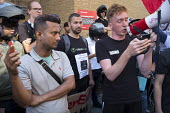 Striking UberEats food delivery couriers protest outside the groups London HQ over pay cuts. - Philip Wolmuth - 26-08-2016