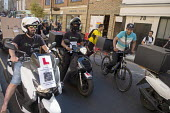 Striking UberEats food delivery couriers protest outside the groups London HQ over pay cuts. - Philip Wolmuth - 2010s,2016,activist,activists,against,BAME,BAMEs,BEMM,BEMMs,bicycle,bicycles,BICYCLING,Bicyclist,Bicyclists,BIKE,BIKES,Black,BME,bmes,CAMPAIGN,campaigner,campaigners,CAMPAIGNING,CAMPAIGNS,casual,citie