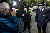 Police officers performing a stop and search are annoyed with their photographs being taken by photographer David Hoffman - Stop the Islamisation of Europe holds its first demonstration in London to c... - Jess Hurd - 2000s,2007,activist,activists,adult,adults,camera cameras,CAMPAIGN,campaigner,campaigners,CAMPAIGNING,CAMPAIGNS,CLJ,David Hoffman,DEMONSTRATING,Demonstration,DEMONSTRATIONS,Europe,journalism,journalis