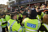 Photographer David Hoffman is rescued after being targeted on an English Defence League march in Dagenham, Essex. - Jess Hurd - 14-01-2012