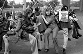 Women at TRICO on strike for Equal Pay relaxing in a playground after a protest, Brentford, London 1976 - Chris Davies - 1970s,1976,activist,activists,against,at,AUEW,black,campaign,campaigner,campaigners,campaigning,CAMPAIGNS,DEMONSTRATING,DEMONSTRATION,DEMONSTRATIONS,disputes,Equal Pay,Equal Rights,equality,fair pay,f