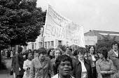 Women at TRICO on strike for Equal Pay protest Brentford, London, 1976 - Chris Davies - 1970s,1976,activist,activists,against,at,AUEW,BAME,BAMEs,banner,banners,black,BME,bmes,campaign,campaigner,campaigners,campaigning,CAMPAIGNS,DEMONSTRATING,Demonstration,DEMONSTRATIONS,disputes,diversi