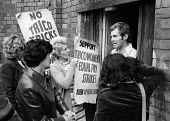 Women workers at TRICO on strike for Equal Pay talking to Peter Rainer of Phoenix Transport. The women were angry that their lorries were strike breaking by crossing their picket line, Brentford, Lond... - Chris Davies - 1970s,1976,ACTIVIST,ACTIVISTS,anger,angry,argue,arguing,argument,at,AUEW,boss,bosses,breaker,breakers,breaking,campaign,campaigner,campaigners,campaigning,CAMPAIGNS,communicating,communication,confron
